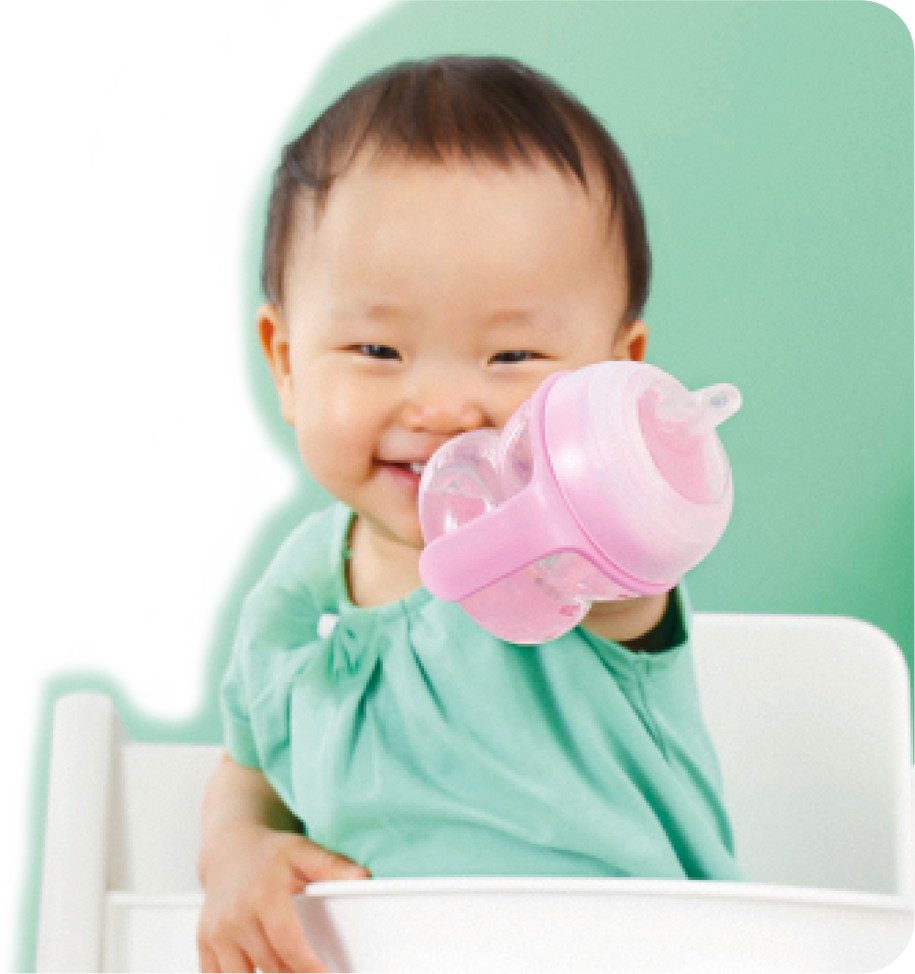 baby with training cup